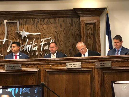 From left, Wichita Falls Mayor Stephen Santellana, newly sworn-in Councilor for District 3 Jeff Browning, Councilor Bobby Whiteley and Councilor Eric West listen Tuesday during a prebudget presentation. Browning was chosen out of seven candidates for the interim position.