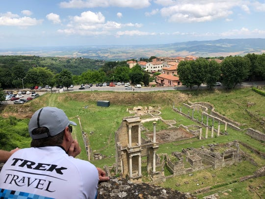 David Fuller, of Dallas, looks at the ruins in Volterra,