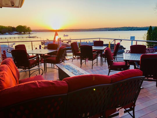 The second-story patio at Edgewater Supper Club, W278-N2315 Prospect Ave., Pewaukee, is small (three tables plus lounge seating) but comes with a big view of Pewaukee Lake and its sunsets.