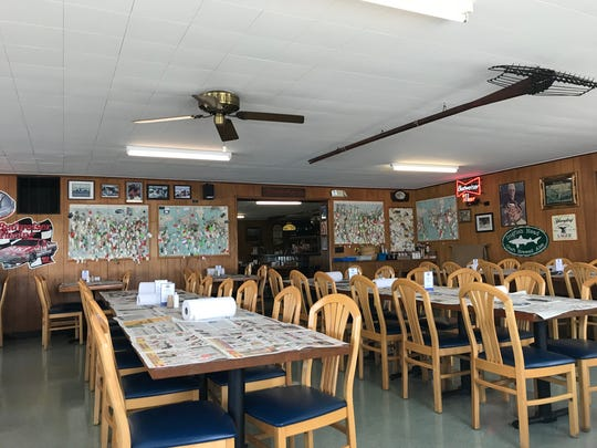 Newspapers serve as tablecloths at Sambo's Tavern, a classic Kent County crab house.