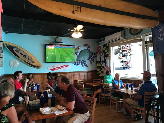 The indoor eating area at Woody's Dewey Beach Bar & Grill.