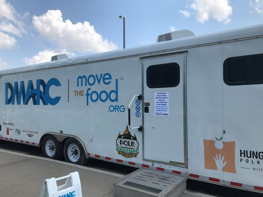 A mobile food pantry operated by DMARC assures flood victims they won't be penalized for seeking more than their usual monthly rations.