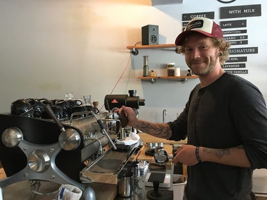 Chay Menke, cafémanager, works at the new Slayer espresso machine at Bloom Coffee Roasters Caféin Old Town, July 3, 2018. They reopened in May.