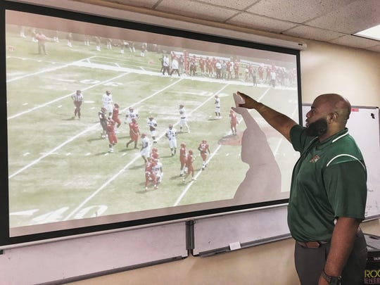 Florida A&M offensive coordinator, Alex Jackson, breaks down alignment during a film session.