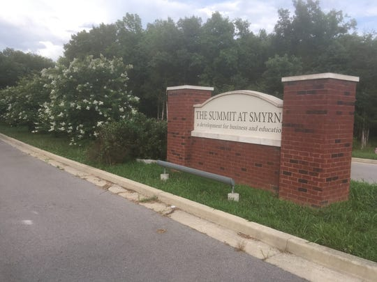 This sign for The Summit at Smyrna shows an entrance to property the Town Council hopes to sell for business and education development near Motlow State Community College and across the street from the YMCA.