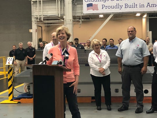 U.S. Sen. Tammy Baldwin laughs during a news conference
