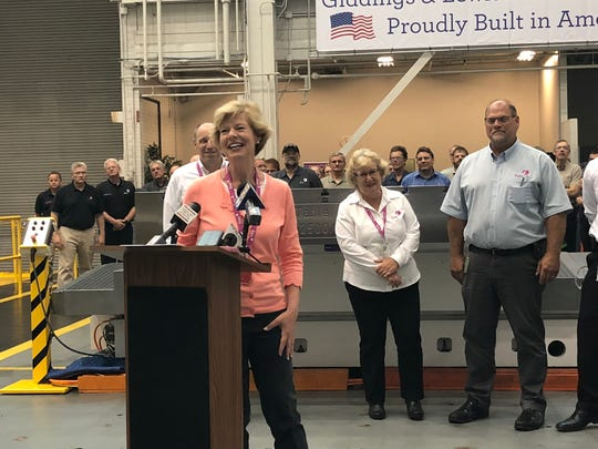U.S. Sen. Tammy Baldwin laughs during a news conference Thursday, July 5, 2018, at Fives Giddings & Lewis in Fond du Lac.