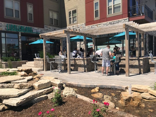 The new Fiddleheads Cafe in Grafton, 1505 Wisconsin Ave., has seating at high-top and standard tables beside a water feature that runs like a stream past the patio.