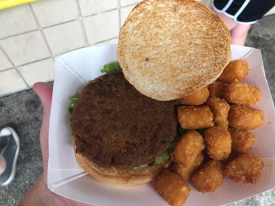 The Beyond Burger from AJ Bombers,with a side of tots.