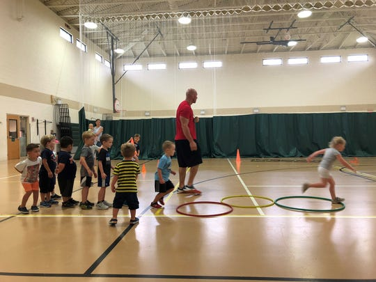 Coach Reed conducts a Lil Sports class at the Viera Regional Rec Center.
