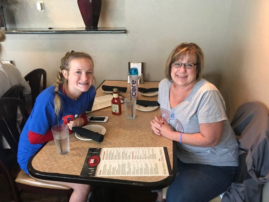 (From left) Annah and Brenda Nieman of Atlanta enjoy lunch at a downtown Detroit restaurant. The pair were in town for the USA Volleyball Girls Junior Tournament.