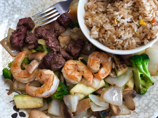 The steak and shrimp entree is $10.95 and includes fried rice, vegetables and soup made with beef broth, mushrooms, fried onions and scallions.