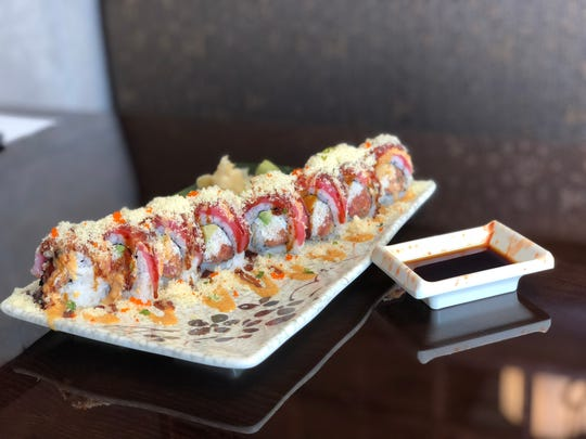 The Chocolate City Roll is made with spicy tuna, snowkrab and avocado. The $10 roll is wrapped with tuna and sprinkled with crunchy tempura bits.