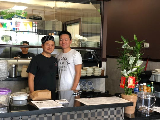 Wei Yang, pictured left, is the uncle of Mike Yang