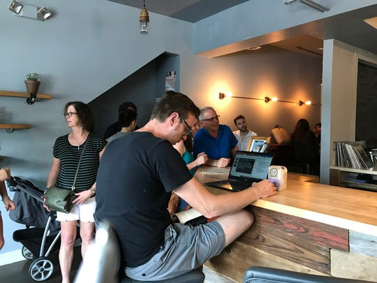 Customers waiting for coffee at Bloom Coffee Roasters Caféin Old Town, July 3, 2018.