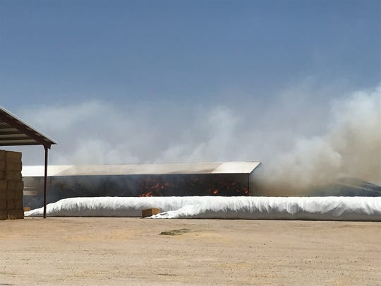 Nearly 120 firefighters responded to a large hay fire