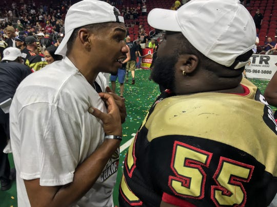 Iowa Barnstormers players talk after their United Bowl win over Sioux Falls on Saturday.
