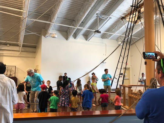 Families gathered to enjoy the festivities surrounding the Kalmar Nyckel on Saturday with crafts, tours and learning the art of being a pirate.