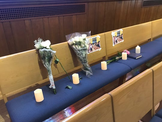 St. Anastasia Church marked the pew the Trinidad family sat in each week with flowers and candles.