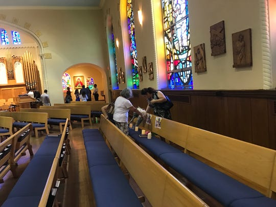 Parishioners remember the Trinidad family, killed in a fatal car crash in Delaware.