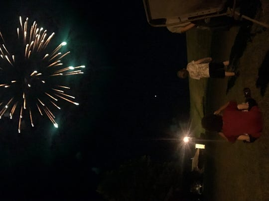 Noah Black and Colton Brittain watch fireworks.