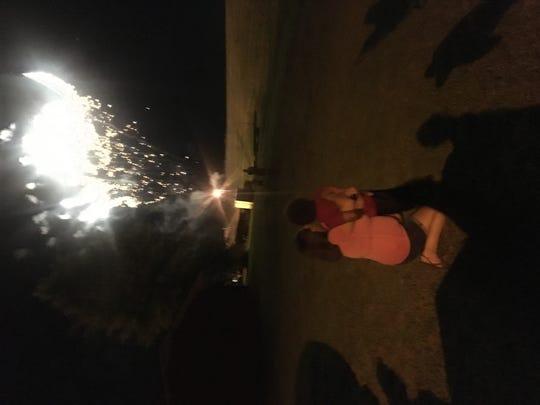 Misa Brittain and her son, Noah Black watch fireworks