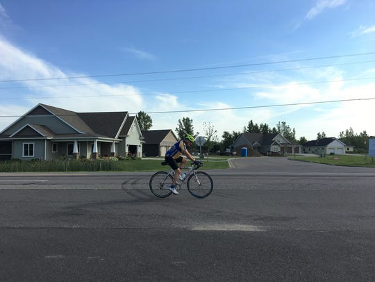 A lone cyclist rides along College Avenue South during