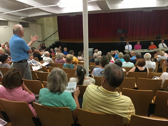 A man speakers about the Des Moines Teachers Retirement