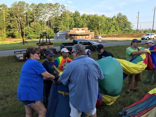 The flight crew packs Pat Harwell's balloon following