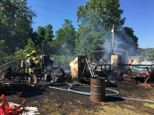 A fire destroyed a structure behind a Churchville home