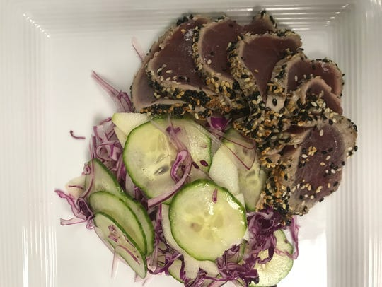 Sesame Seared Tuna Salad with cucumber, red onion, purple cabbage, Asian pear and mirin vinaigrette is served for lunch at Kitchen 919.