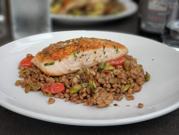 Pan-seared salmon with farro ($26) from Empire Kitchen