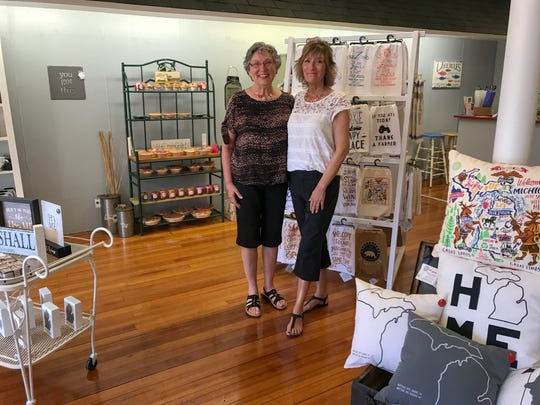 Kathy Pryor (left) and Michele Wilkerson are sisters who opened a Michigan-themed gift store in Marshall in June.