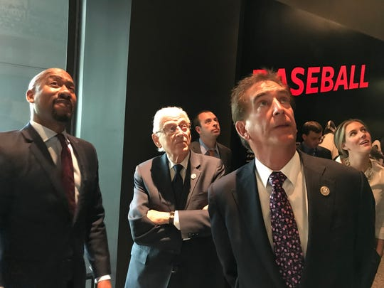 Sports curator Damion L. Thomas points to exhibits in the National Museum of African American History and Culture about the integration of baseball during a July 11, 2018 tour by Reps. Bill Pascrell, D-Paterson, and James Renacci, R-Ohio, sponsors of a bill the House approved awarding a Congressional Gold Medal to Paterson's Larry Doby, the first black player in the American League.