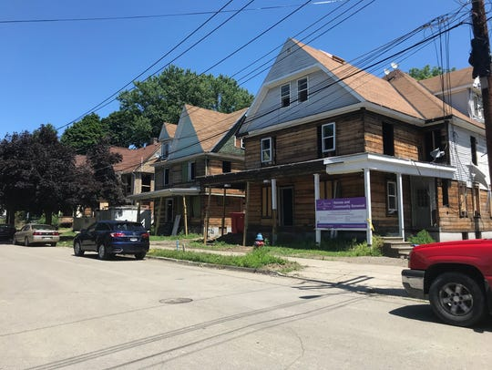 Houses under construction along Crandall Street in