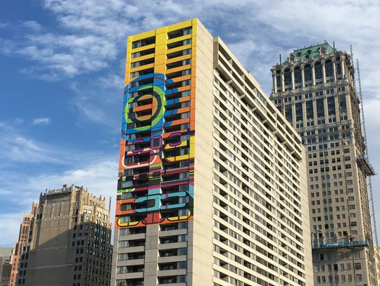 "Beverly Fishman's ""Rise"" is on the apartment building"