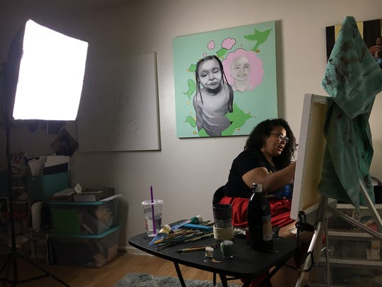 Phoenix-based artist Antoinette Cauley paints in her