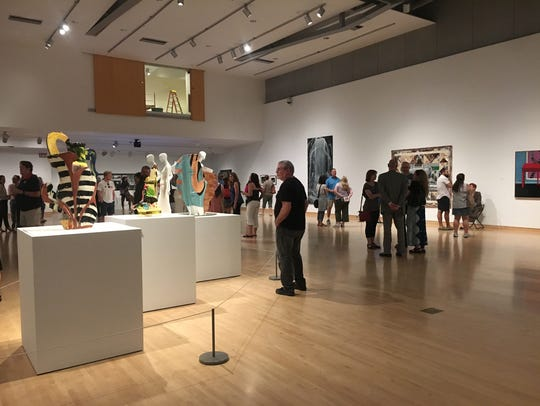 Phoenix Art Museum patrons check out the museum's newest