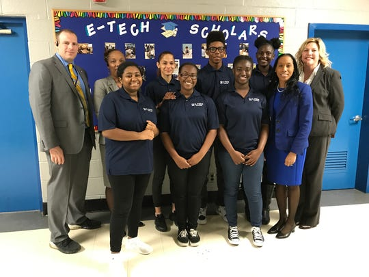Former E-TECH Principal Daniel Wilson poses with students,
