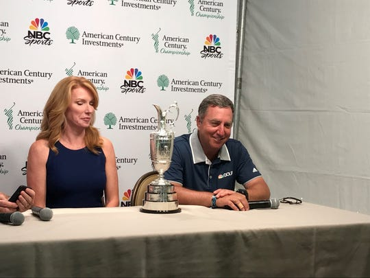 Heather Cox and Jo Miller, both with NBC Sports, sit behind the Claret Jug trophy Wednesday at Edgewood.