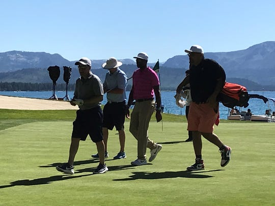 Jerry Rice walks off the green on hole No 17 at Edgewood Tahoe on Wednesday.