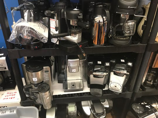 A lot of coffee makers at the sale.