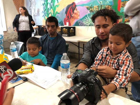 Immigrant fathers reunited with children 2