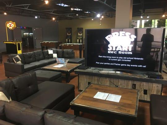 Press Start Rec Room, 830 Vanderperren Way, Ashwaubenon, features arcade, board, recreation and video games, as well as food, beer and wine.