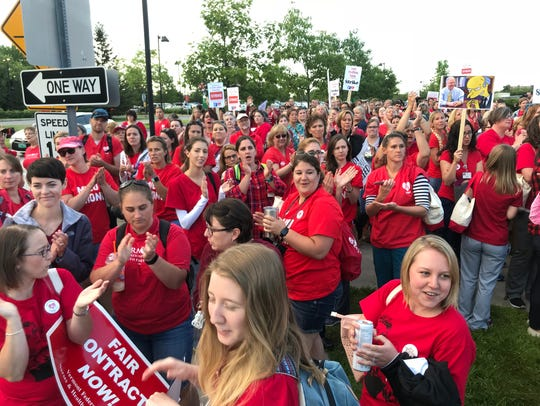 UVM Medical Center nurses gather early Thursday in