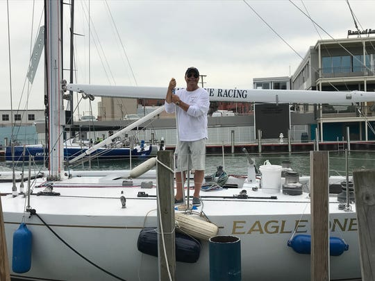 Eagle One Skipper Tim Lariviere poses for a photo in