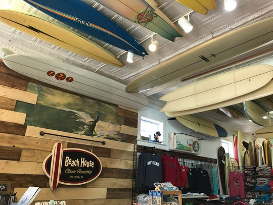 Display of historic surfboards on the ceiling at Beach