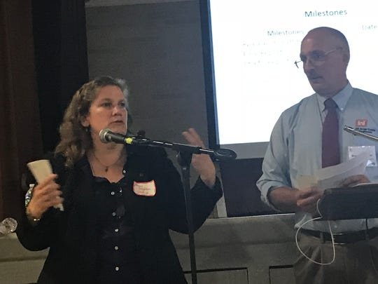 Left, Nancy Brighton,  Chief, Watershed Section, Environmental Analysis Branch, Planning Division, for the U.S. Army Corps of Engineers, addresses the public along with Army Corps Project Manager Bryce Wisemiller.