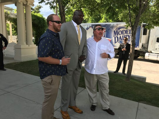 Shaquille O'Neal poses with boosters Thursday at the Governor's Mansion in Carson City.
