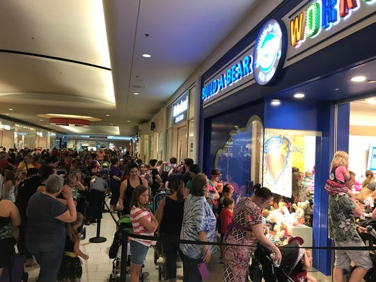 """The scene at Build-a-Bear Workshop in the Empire Mall at about noon on Thursday as customers seek to take advantage of a one day long, """"Pay Your Age"""" special."""